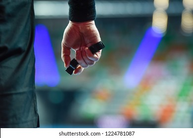 handball referee hand with whistle