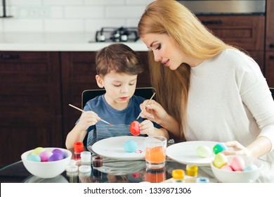 In Handcraft workshop for families, woman and male child. Learning new skills. Spending time together. The children are encouraged to pursue activities of their choice like creative arts