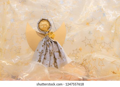 handcrafted angel, creative work with christmas background, organza fabric with stars