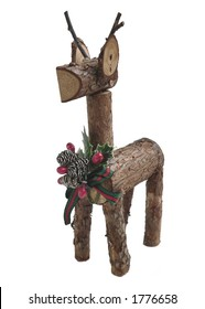 Handcrafted Christmas decoration of one reindeer isolated on white. The deer is crafter out of sticks with the bark still one. There is a Christmas decoration on his chest. Vertical composition.