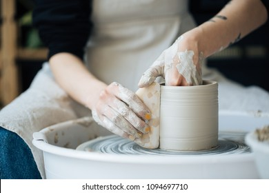 Handcrafted on a potter's wheel,Hands make clay from various items for home and sale in the store and at the exhibition, ceramic items are made in hand, the clay billet becomes a ceramic dish