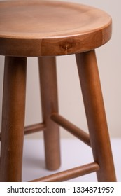 Handcrafted wooden backless stool on white background isolated