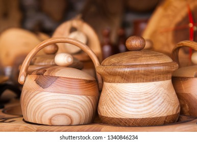 Handcrafted wooden dishes. Village Market. Sale of dishes.