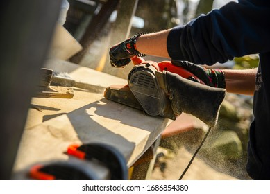 Handcrafting wooden furniture with power tools - Shutterstock ID 1686854380