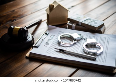 The handcuff is placed on a contract of sale. The concept is not fair to the contract. - Shutterstock ID 1347880742