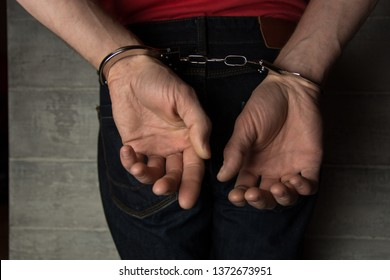 handcuffed man from behind