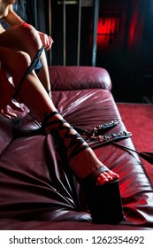 Handcuffed woman for bdsm. Sex slave. Beauty woman with attractive body in lingerie.  Female ass in underwear. Naked girl