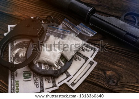 handcuffs American dollar bills