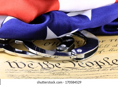 Handcuffs and American flag on US Constitution - Fourth Amendment