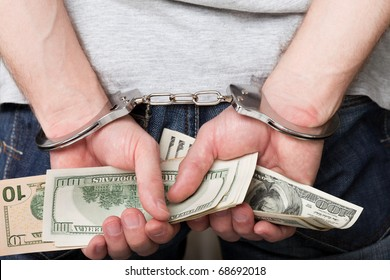 Handcuffs arrests dollar currency crime human hand