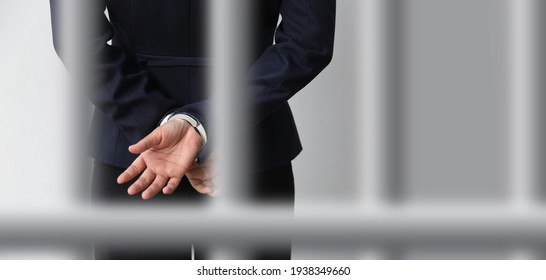 Handcuffs lock the accused fetters to jail the investigation process after court.On a white background with blur cage