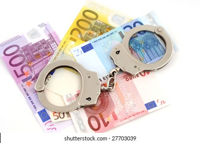 Handcuffs with money on white background