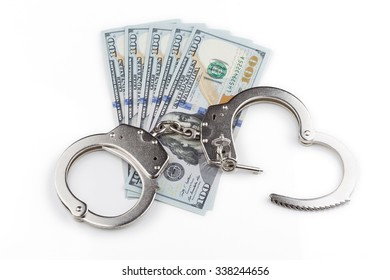 handcuffs on the background of banknotes dollar