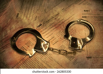 Handcuffs on form 1040 - federal tax fraud and scam
