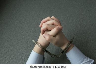 Handcuffs on hands of a businessman.