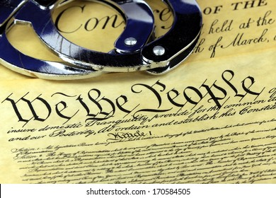 Handcuffs on US Constitution We the People - Fourth Amendment