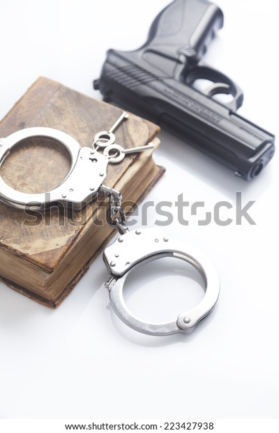 handcuffs and police gun