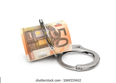 Handcuffs with rolled up euro bills on white background.
