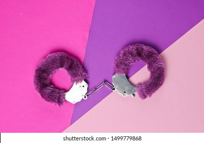 Handcuffs for sex games on colored background. Sexual bdsm toy. Fetish, erotic concept. Top view