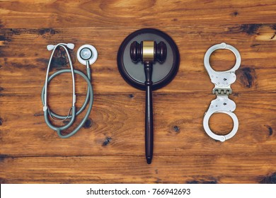 Handcuffs, stethoscope and  judge gavel. Concept of healthcare and medicine, malpractice, legal system.