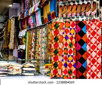 Handembroidered phulkari dupatta and Punjabi Jutti in local market shop.