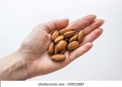 Handful of almonds in the hand