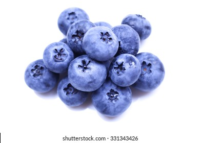 A handful of blueberries on a white background. Isolate on white background. Berries. Sweet and delicious berries. Fruits and berries. Harvest, farming. Growing berries. Juicy and sweet blueberries.