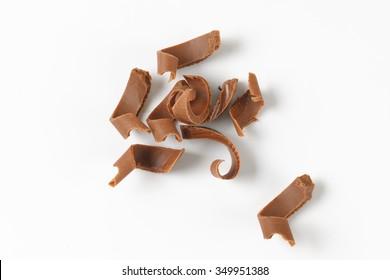 handful of chocolate shavings on white background