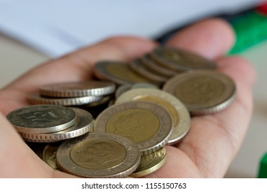 Handful of coins in palm hand