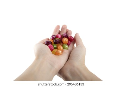 handful colorful candies isolated over white