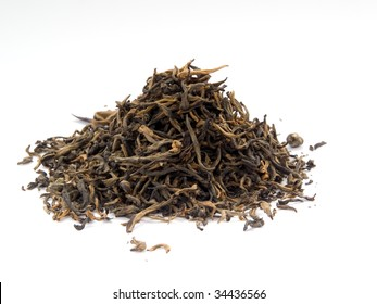 Handful of dry black tea isolated on white background
