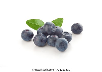 Handful of fresh blueberry with green leaves