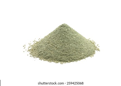 handful of green cosmetic clay on a white background
