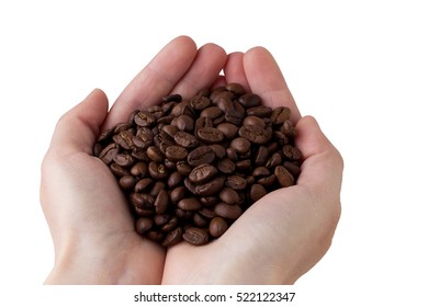The handful of high-quality coffee beans in hands