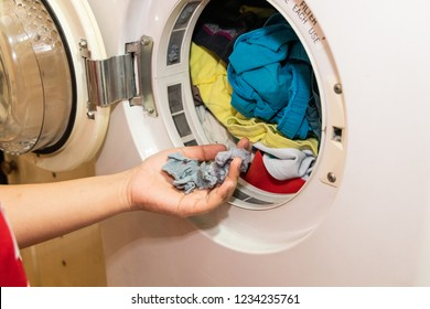 Handful of lint trapped in filter of laundry dryer clothes machine, after drying.