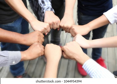 handful of men and women touch together teamwork concept. People collaboration joining for cooperation sucess.