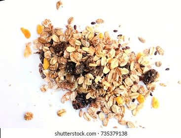 A handful of muesli with dried fruit on white background