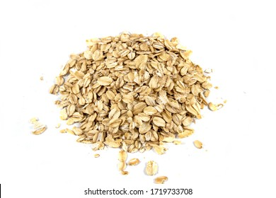 Handful of raw rolled oats. Isolated