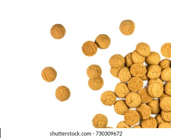 Handful of Scattered Pepernoten cookies as Sinterklaas decoration on white background for dutch sinterklaasfeest holiday event on december 5th