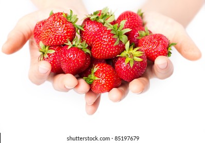 handful of strawberries isolated on white close-up