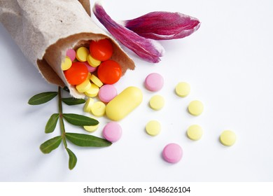 the handful of tablets, dietary supplements, vitamins get enough sleep from the paper bag made of textured solid paper