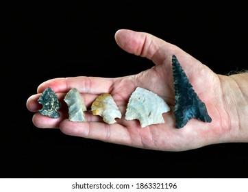 A handfull of real Texas arrowheads made around 7000 years ago.