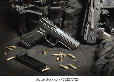 handgun with ammunition on a black surface
