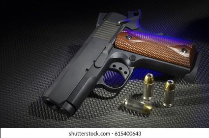 Handgun with ammunition on a rubber mat and blue highlights