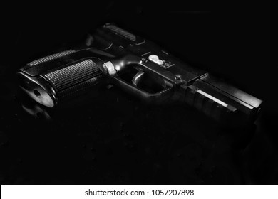 Handgun in the black background with no any logo.