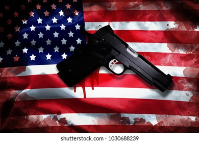 handgun with blood stain on American flag. reform gun control in America concept