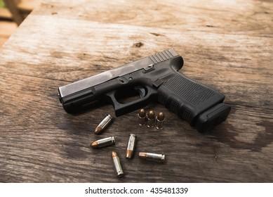 handgun bullets on wood table