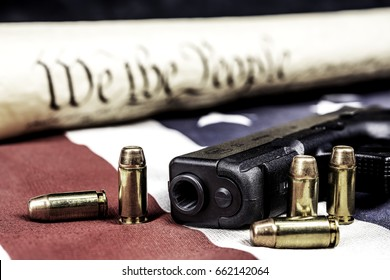 A handgun with bullets symbolizing gun rights while framed against the United States constitution.