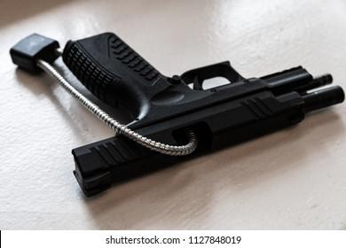 Handgun with Chamber Lock Showing Gun Safety