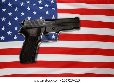 Handgun in front of American flag